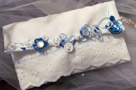 Button embellished bridal clutch