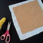 Cut fabric to fit cork board