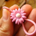 Ponytail holder made with a button