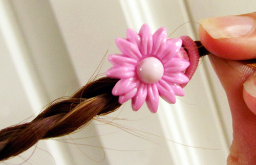 Pink flower button ponytail holder
