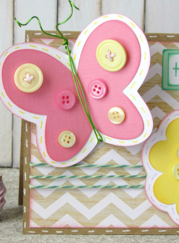 butterfly die cut embellished with spring buttons