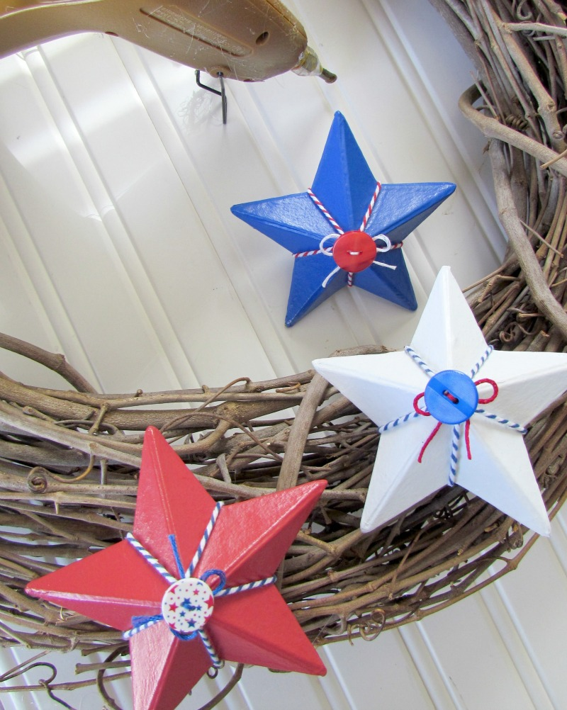 Hot glue painted stars onto a grapevine wreath