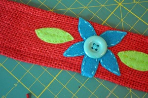 Sew on felt pieces and buttons