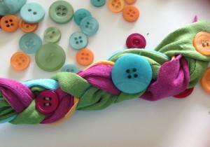 sew buttons to bracelet