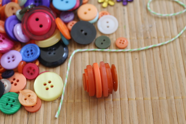 Button Pumpkins -- make your own DIY craft pumpkins from just buttons and glue.  Learn how to with this tutorial.
