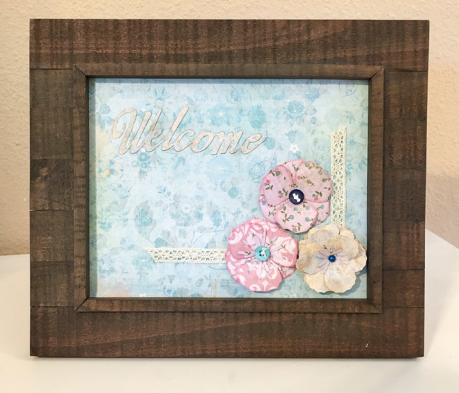 Welcome frame featuring 28 Lilac Lane products by May Flaum from Buttons Galore. Easy photo frame home decor project.