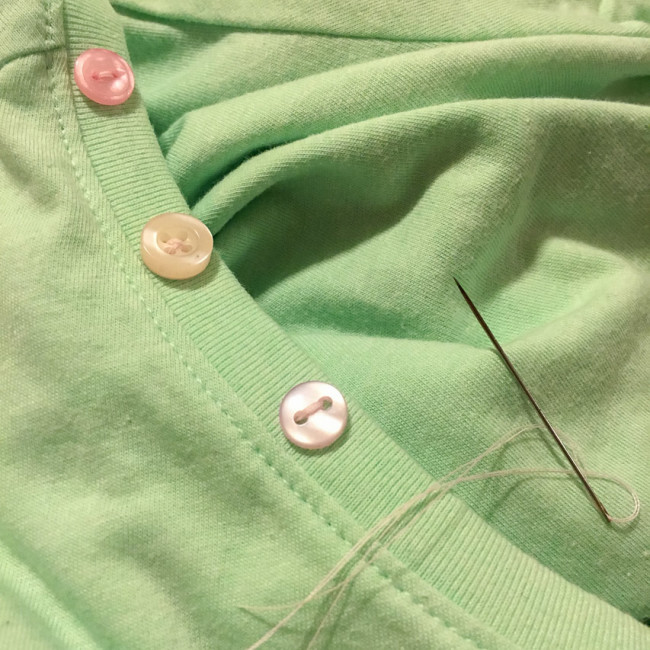 Sewing buttons on neckline