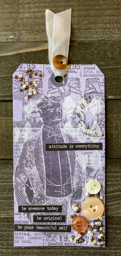 Mixed Media Tag by Nancy Nally featuring 28 Lilac Lane embellishment kits