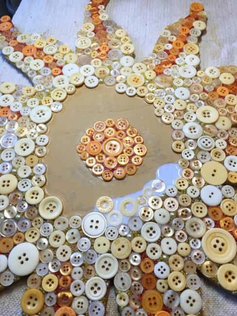 Button Sun Mosaic Construction