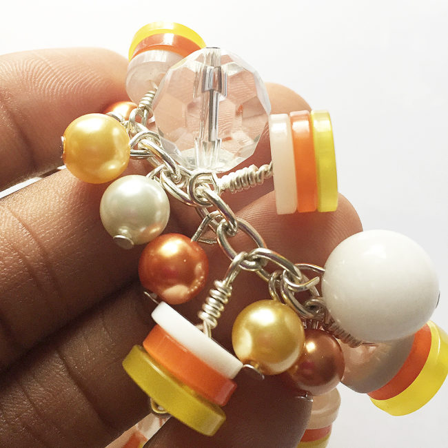 how to make a candy corn bracelet using 28 Lilac Lane buttons!
