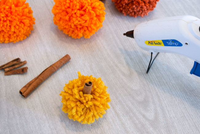 Pom Pom Pumpkins with Cinnamon Stick Stems
